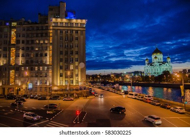 Moscow night landscape with road and river and church of Christ Savior
