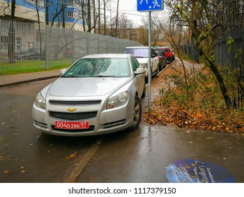 MOSCOW – NOVEMBER 12, 2017: Car belonging to US Embassy parked with violation of rule on grass-plat along road on November 12, 2017 in Moscow.