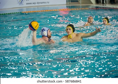 MOSCOW - NOVEMBER 18, 2016: Egor Emelyanov (2) in action at a Russia national championship water-polo game between Dynamo-Moscow (white) vs STORM-2002 (black) Dynamo won 10-6