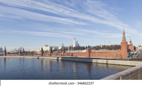 Moscow - November 29, 2015: View towards the Kremlin embankment on to the Big Moscow River bridge in the morning, and the snow lies on the lawns of the Kremlin November 29, 2015, Moscow, Russia