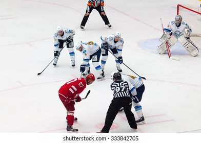 MOSCOW - OCTOBER 17, 2015: Yury Koksharov (27) on faceoff during hockey game Vityaz vs Barys on Russia KHL championship on October 17, 2015, in Moscow, Russia. Vityaz won 4:3