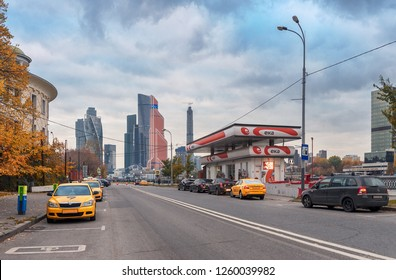 """Moscow - October 21, 2018: Filling station """"ESA"""" on Taras Shevchenko embankment and yellow taxis in the parking lot against the background of international business center """"Moscow-City"""""""