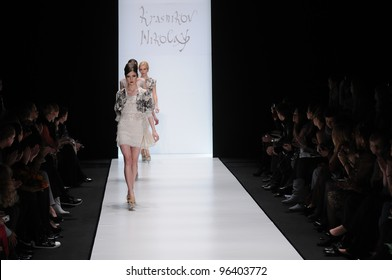 MOSCOW - OCTOBER 22: Models walks runway at the Nikolay Krasnikov Collection for Spring/ Summer 2012 during Mercedes-Benz Fashion Week on October 22, 2011 in Moscow, Russia
