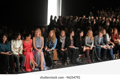 MOSCOW - OCTOBER 22: VIP guests and editors attends runway at the Costume National Collection for Spring/ Summer 2012 during Mercedes-Benz Fashion Week on October 22, 2011 in Moscow, Russia