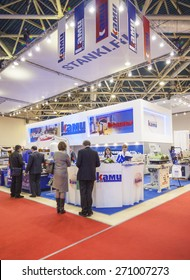 MOSCOW - OCTOBER 24, 2012: Unidentified visitors examining woodworking machines Russian company CAMI at the International exhibition LESDREVMASH