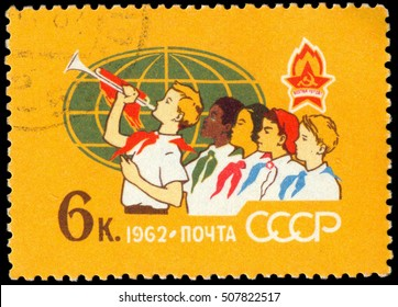 MOSCOW, October 25, 2016: RUSSIA - CIRCA 1962: stamp printed by Russia, shows Pioneers of many races and globe, circa 1962
