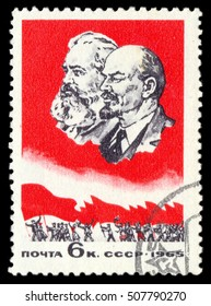 MOSCOW, October 25, 2016: USSR - CIRCA 1965: A stamp printed in USSR shows portrait of Karl Marx and Vladimir Lenin on the background of a red flag without inscription, circa 1965