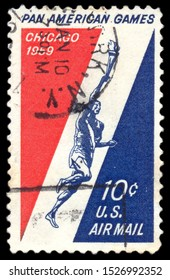 MOSCOW, October 6, 2019:  A stamp printed in the United States of America shows Runner Holding Torch, 3rd Pan American Games, Chicago, circa 1959