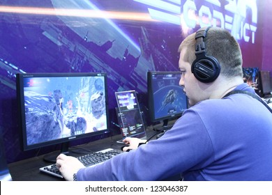 MOSCOW- OCTOBER 7:  People playing video games at the international exhibition of  the entertainment industry, Igromir on October 7, 2012 in Moscow
