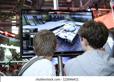MOSCOW- OCTOBER 7:  Unidentified young people playing video games at the international exhibition of  the entertainment industry, Igromir on October 7, 2012 in Moscow