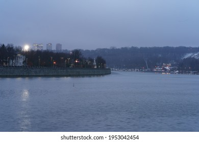 Moscow park Vorobievy Gory and Moscva river in blue colors at night spring time. Dull sunset, rain,