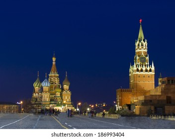 Moscow, Red square at night, with St. Basils Intercession cathedral and Spasskaya Kremlin tower.