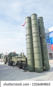"""MOSCOW REGION, ALABINO, RUSSIA - April 13, 2016 : Launcher 5P85TE2 with truck BAZ-64022 Russian anti-aircraft missile system S-400 in the military-Patriotic Park """"Patriot"""", rear view-side"""
