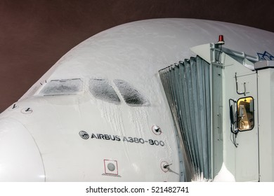 Moscow region, Domodedovo, Russia - January 16, 2016: Closeup high detailed view on Airbus A380 Emirates A6-EES - two-decked passenger airliner at snowy night time at Domodedovo international airport