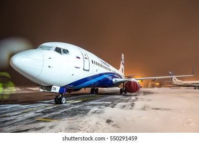 Moscow region, Domodedovo, Russia - January 16, 2016: Modern passenger aircraft Boeing 737-800 VQ-BDN Nordstar standing at Domodedovo international airport at snowy night.