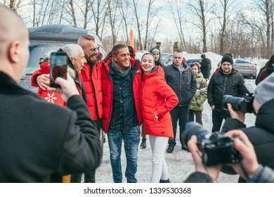 MOSCOW REGION, FRYAZINO, GREBNEVO ESTATE - MARCH 09 2019: Samy Naceri French actor of Taxi films and his brother Bibi Nacery visiting the Grebnevo. Samy photographing with a local beautiful girl