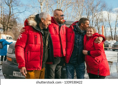 MOSCOW REGION, FRYAZINO, GREBNEVO ESTATE - MARCH 09 2019: Samy Naceri French actor of Taxi films and his brother Bibi Nacery visiting the Grebnevo. Samy hugs and kissing head of happy local woman