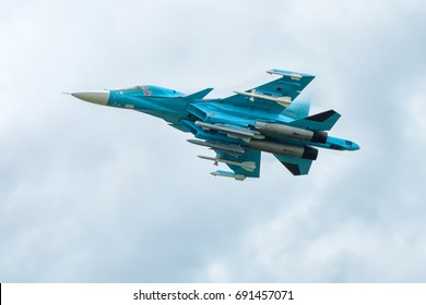 Moscow Region - July 21, 2017: Russian Air Force Sukhoi Su-34 at MAKS. Modern fighter-bomber Su-34 with armament flies in the sky. Military plane Su-34 performs a demonstration flight.
