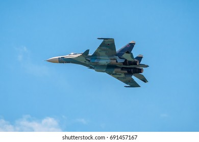 Moscow Region - July 21, 2017: Modern Russian strike fighter Su-30 at MAKS. Russian air force fighter is flying in the blue sky.