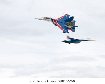 """Moscow Region - June 17, 2015: Aerobatic team Russian Knights in air shows an attack on an international military-technical forum """"Army 2015"""" June 17, 2015, Moscow Region, Russia"""