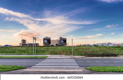 Moscow region. June 21, 2017. Skolkovo Innovation Center in the rays of the setting sun. Pedestrian crossing across the road to the Technopark.