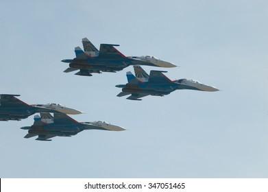 """Moscow region, Kubinka, RUSSIA - April 19, 2013: Four Russian Su-27 aerobatic team """"Russian knights"""" in flight"""