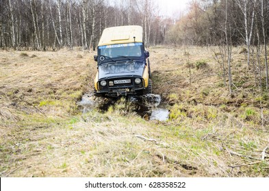 Moscow region, Russia. 04.21.2017. The sport utility vehicle (SUV) is driving in the forest near the town of Bronnitsy, Moscow region, Russia, April 21, 2017. The yellow car. Photo with lens flare