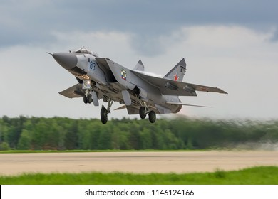 MOSCOW REGION, RUSSIA, 5 MAY 2015: Mig-31 Foxhound of Russian air force perfoming take off from the airbase runway in Russia. Air fighter flying around base. Aviation mission of military flight
