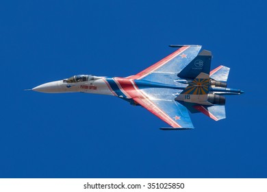 """Moscow region, Russia - April 19, 2013: Russian fighter Sukhoi Su-27 of an aerobatic demonstration team of the Russian Air Force """"Russian Knights"""" (Russkiye Vityazi) in flight."""