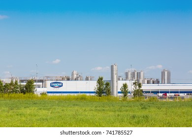 MOSCOW REGION, RUSSIA - AUGUST, 2017: Danone factory in Russia with green grass and blue sky.
