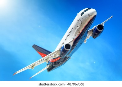 MOSCOW REGION, RUSSIA - CIRCA AUGUST, 2015: Sukhoi Civil Aircraft company Sukhoi Superjet 100 VIP SSJ twin engine corporate business jet plane banking detail exterior aerial view