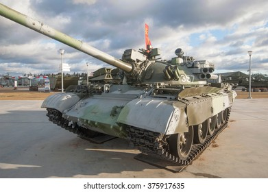 "MOSCOW REGION, RUSSIA - DECEMBER 8, 2015 : Old Soviet camo T-55AD with the system of active protection ""Drozd"" in the new Park ""Patriot"", front view"