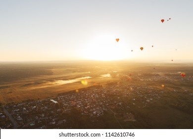 Moscow region, Russia. Festival of balloons at sunset. Flying on a summer evening over the fields in the golden sunlight