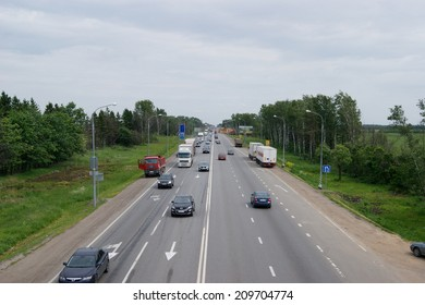 MOSCOW REGION, RUSSIA - JUNE 2, 2012: Car traffic on the four-lane highway