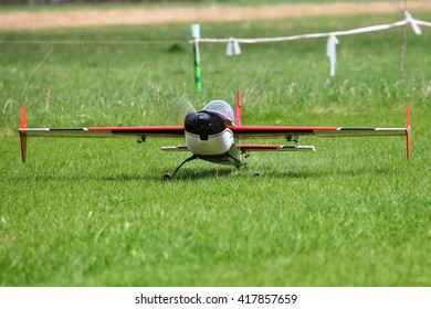 MOSCOW REGION, RUSSIA - MAY 08, 2016: Radio control plane Extra300 (Extreme Flight) is taxiing to the runway
