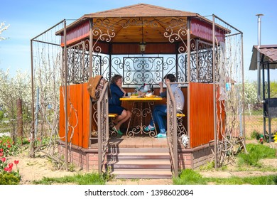 MOSCOW REGION, RUSSIA - May 10.2015: The family is going to drink tea and have lunch at the dacha