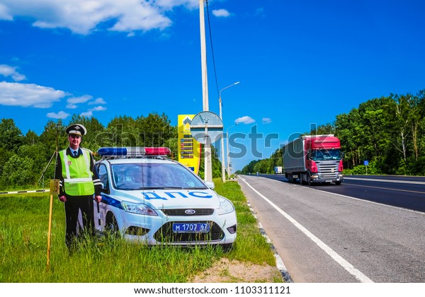 Moscow region, Russia - may, 29, 2018: sham policeman on a road wayside. Such models are used by police in Russia to prevent accidents.