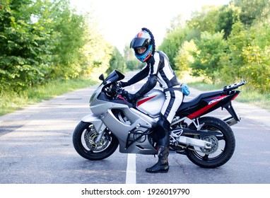 moscow region, russian federation, august 2016, young beautiful woman on a honda motorcycle on the road