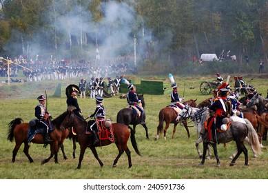 MOSCOW REGION - SEPTEMBER 07, 2014: Reenactors dressed as Napoleonic war soldiers ride horses at Borodino battle historical reenactment.