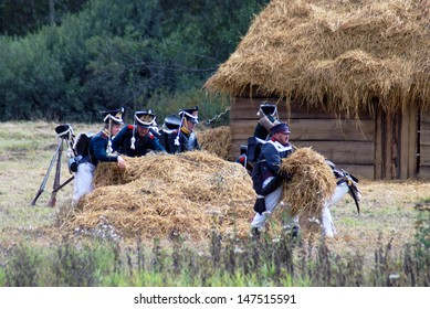 MOSCOW REGION - SEPTEMBER 4: Reenactors dressed as Napoleonic war soldiers walk on September 4, 2011 in Borodino, Moscow Region, Russia. They reenact the Borodino battle held in 1812.