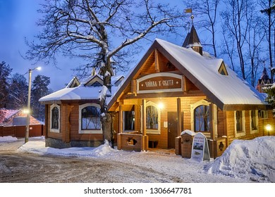 MOSCOW REGION, ZVENIGOROD, RUSSIA - January 31, 2019 Covered snow illuminated with spotlights wooden teahouse at the skete (hermitage) of St. Savva (St. Sabbas) in Zvenigorod in a winter twilight.