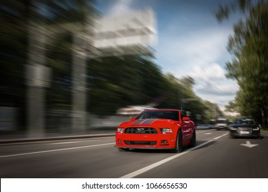 Moscow, RU - JUN 31, 2017: Red Ford Mustang GT go fast on highway
