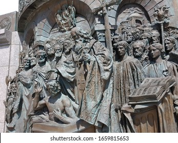 Moscow, RU - JUNE 2, 2019: The old bronze stucco of Vladimir the Great coronation stories, located near his monument in Borovitskaya Square near Kremlin Red Square in The Central Moscow, Russia.