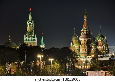 MOSCOW, RUSSA - Lights of Kremlin Ruby Stars and Amazing St. Basil's Cathedral at Night. View from Raushskaya embankment on the main Moscow attractions.