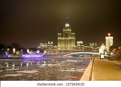 MOSCOW, RUSSI Glowing Kotelnicheskaya Embankment Building on New Year's Eve. Night Moscow cityscape with view on river Moskva (Moscow) and the illuminated residential high-rise building.