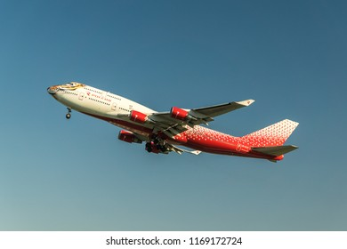"MOSCOW, RUSSIA - 01 august 2018: A Boeing 747 in a special livery with the Amur tiger ""Tigrolet"" airlines Rossiya airlines takes off from Vnukovo international airport in Moscow"