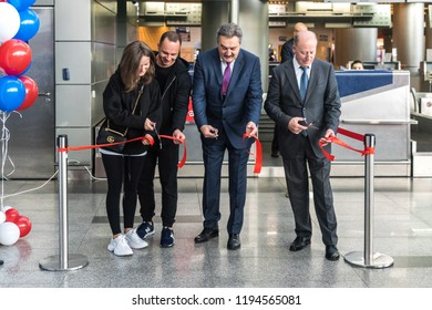 MOSCOW, RUSSIA - 01 october 2018: Vasiliy Alexandrov, General Director of Vnukovo Airport, and Yuri Stogny, Director General of AZUR air Airlines, cut the ribbon with passengers