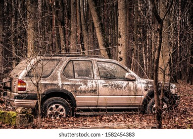 Moscow, Russia - 01.12.2019: Old forgotten out scrap car that has been abandoned in the woods. Damaged and abandoned vehicle. forest landscape with an abandoned car among the trees