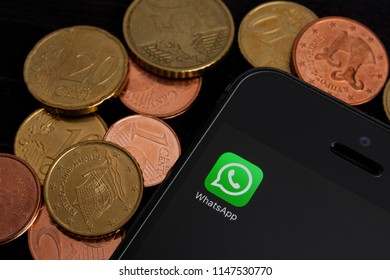 Moscow, Russia- 02 August 2018: Whatsapp application icon on smartphone screen. Phone lies on the table with money. WhatsApp plans to charge a fee from business users (companies). Editorial use only.