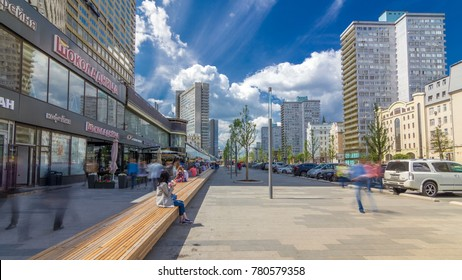 MOSCOW, RUSSIA - 02 JUNE 2017: Walk on New Arbat Avenue timelapse hyperlapse popular tourist street in Moscow with shops and cafe in sunny summer day. Famous landmarks houses as books. People sitting